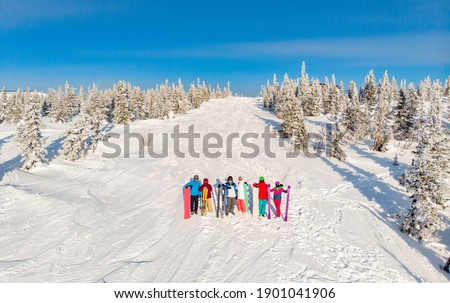 Young couple getting ready to go snowboarding Stock photo © dash
