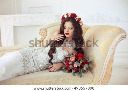 Beautiful brunette Bride lying on Classic elegant sofa, baroque  Stock photo © Victoria_Andreas