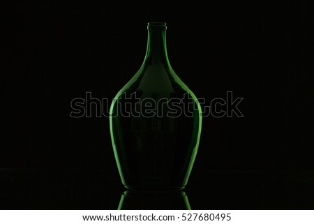 Silhouette of elegant and very old wine bottle on a glass desk Stock photo © CaptureLight
