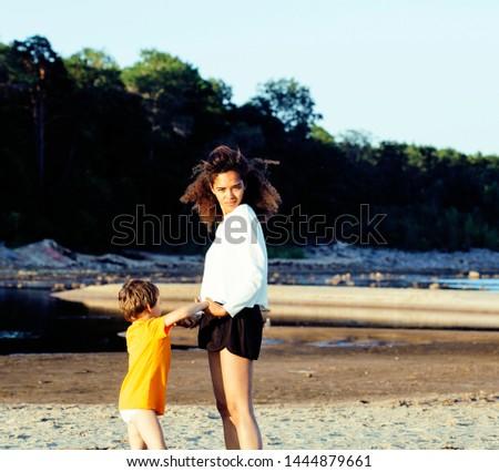 pretty diverse nation and age friends on sea coast having fun, lifestyle people concept on beach vac Stock photo © iordani