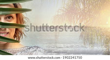 young cute blonde woman on green palm background smiling happy stock photo © iordani