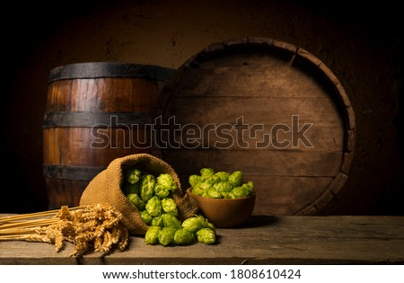 Wooden barrel for wine and beer. Green leaves of hops on barrel Stock photo © orensila