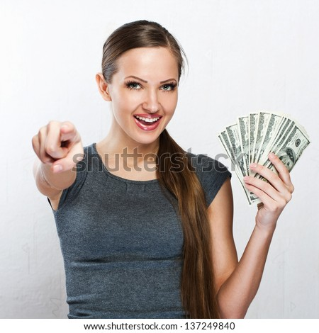 successful brunette adult girl holding fan of 100 dollar bills b stock photo © deandrobot