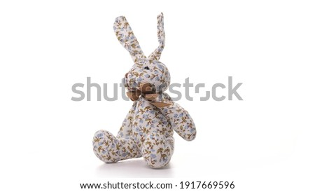 Soft toy in the form of yellow rabbit isolated on white background. Vector cartoon close-up illustra Stock photo © Lady-Luck