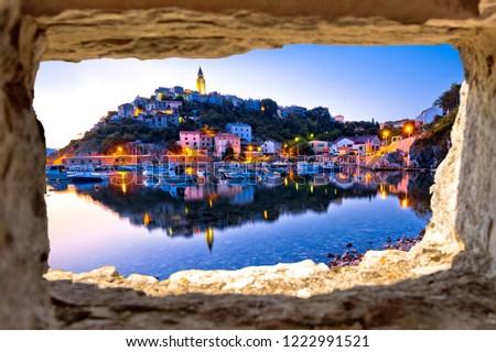 town of vrbnik harbor view morning glow view through stone windo stock photo © xbrchx