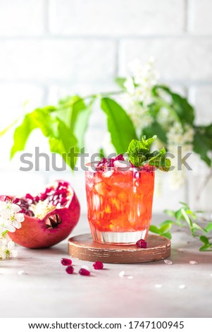 Gin and tonic pomegranate cocktail or detox water with ice Stock photo © artsvitlyna