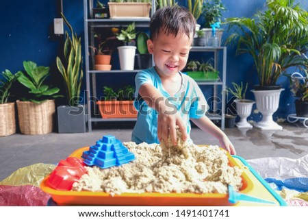 Boy playing with kinetic sand in preschool. The development of fine motor concept. Creativity Game c Stock photo © galitskaya