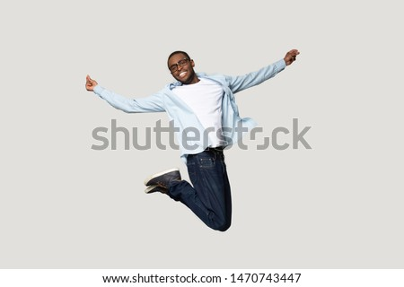 full length photo of happy african american people wearing backp stock photo © deandrobot