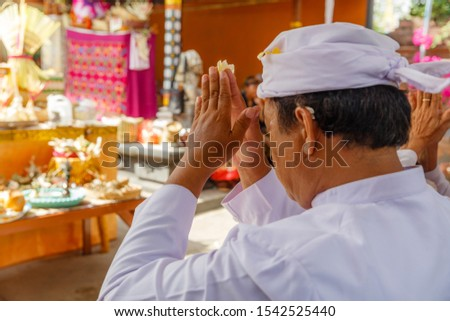 Balinese people in traditional clothes during religious ceremony at Pura Taman Ayun Temple, Bali in  Stock photo © galitskaya