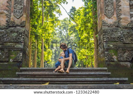 Dad and son travelers discovering Ubud forest in Monkey forest, Bali Indonesia. Traveling with child Stock photo © galitskaya