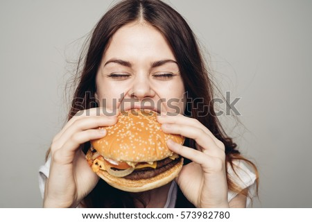 Young woman eating hamburger woman eating junk food, fatty food hamburger BANNER, long format Stock photo © galitskaya