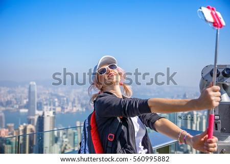 Hong Kong Victoria Peak woman taking selfie stick picture photo with smartphone enjoying view over V Stock photo © galitskaya