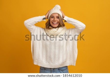 Smiling cheerful young female wears warm woolen sweater, square eyewear, drinks hot beverage, relaxe Stock photo © vkstudio