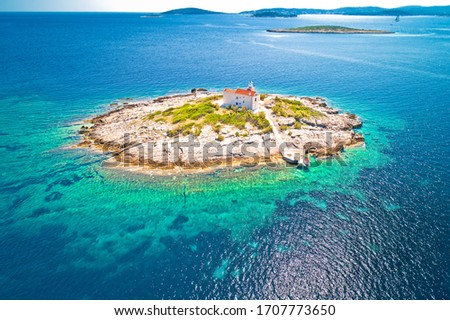 Aerial view of lonely island with lighthouse, island Vela Sestri Stock photo © xbrchx