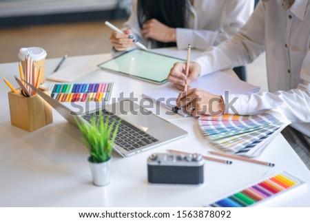 Asian men Architect or graphic designer designing a layout selec Stock photo © snowing