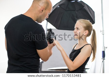 Teenage fashion model being shot by a photographer in a studio Stock photo © lightpoet