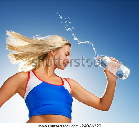 female holding in hand sparkling mineral bottled water isolated  Stock photo © dacasdo