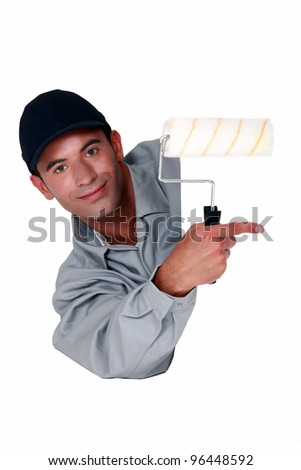 Tradesman holding a paint roller and pointing to a blank sign Stock photo © photography33