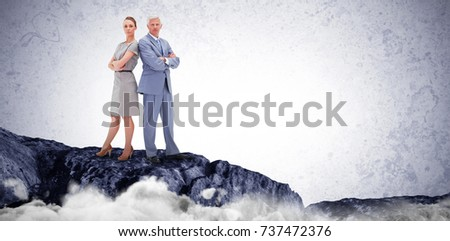 Serious white hair businessman back to back with a woman against white background stock photo © wavebreak_media