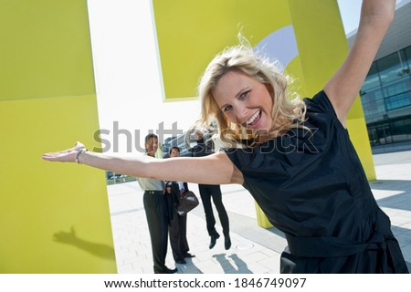Smiling blonde businesswoman looking at her outstretched hand Stock photo © wavebreak_media