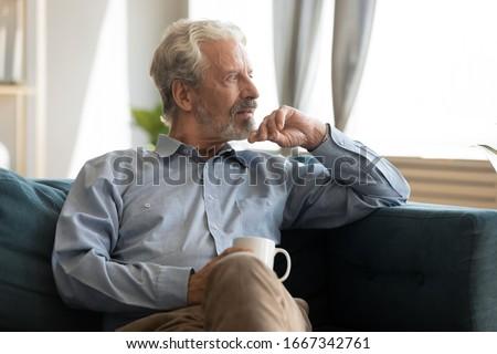 elderly retired man in sorrow Stock photo © meinzahn