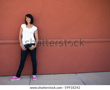 Portrait of smiling girl in red shirt against white wall. Horizontal format. Stock photo © Paha_L
