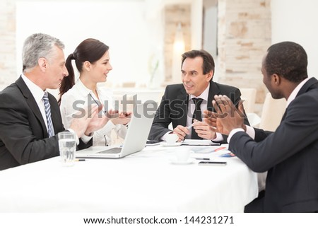 group of multi ethnic business people applauding during presentation stock photo © zurijeta