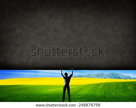 Man raising a concrete wall uncovering a new better world, green landscape Stock photo © photocreo
