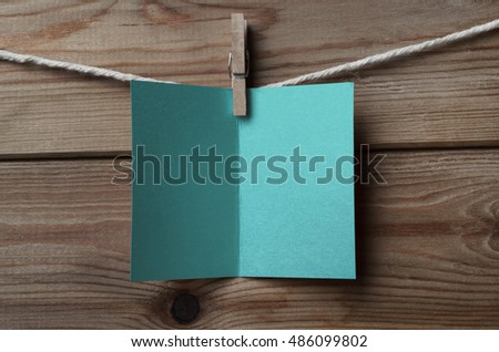 Turquoise Blue Greetings Card Pegged to String on Wood Backgroun Stock photo © frannyanne
