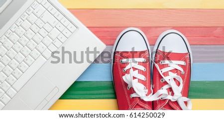 photo of gumshoes on the laptop on the wonderful colorful backgr Stock photo © Massonforstock