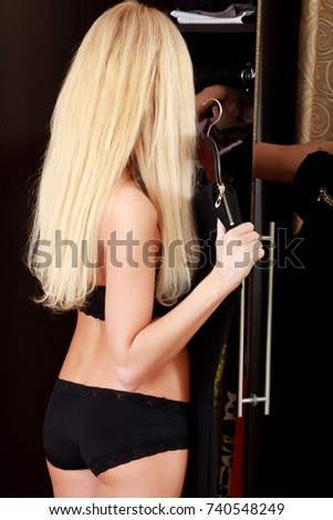 Young woman choose clothes in wardrobe at her place, view from b Stock photo © Nobilior