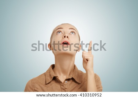Shocked blonde business woman pointing back and looking at camera Stock photo © deandrobot