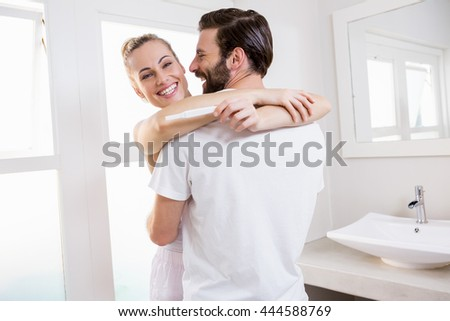 lovers woman and man are happy about positive result of pregna stock photo © kzenon
