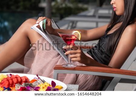 Сток-фото: Beautiful Girl Drinking Cosmopolitan Cocktail Lying Swimming Po