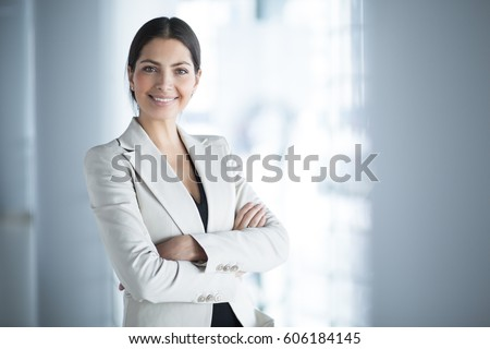 Smiling brunette woman with crossed arms looking at the camera Stock photo © deandrobot