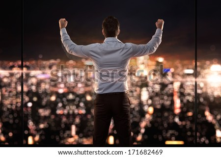Businessman happy and raise hand for success concept, back view  Stock photo © FrameAngel