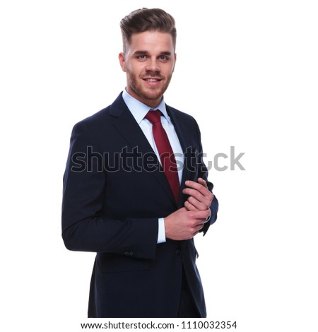 smiling businessman in navy suit and red tie fixing his sleeves Stock photo © feedough