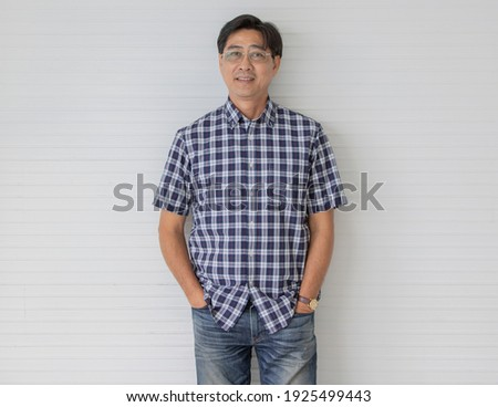 portrait of smiling man wearing plaid shirt and leather jacket Stock photo © feedough