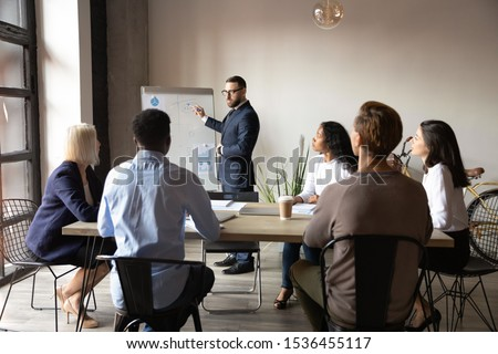 serious businessman in suit presenting project result with flipchart stock photo © marysan