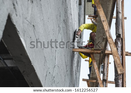 Worker Smoothing Cement with Wooden Float At Construction Site Stock photo © feverpitch