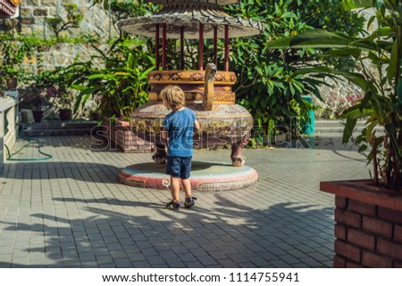 Little boy tourist in Buddhist temple Kek Lok Si in Penang, Malaysia, Georgetown. Traveling with chi Stock photo © galitskaya