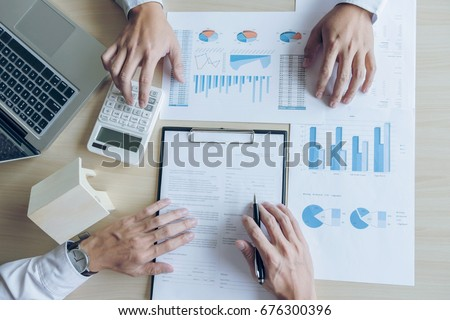 Stock photo: Man sign a home insurance policy on home loans, Agent agent hold