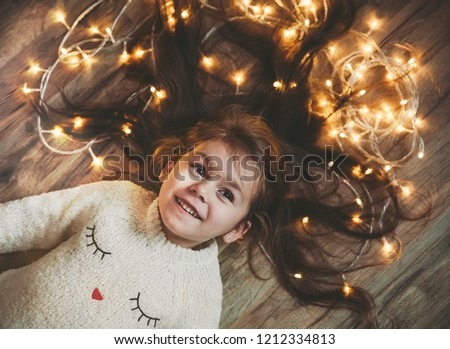 Red hair girl on the background of bright New Year's showcases having fun and posing with cardboard  Stock photo © ElenaBatkova
