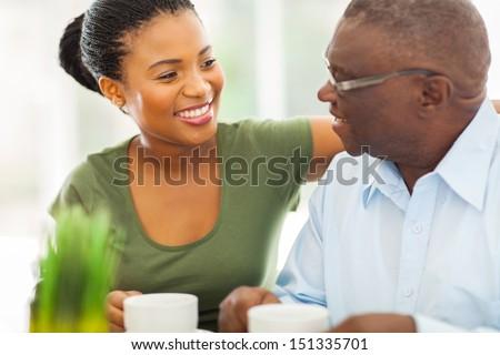 Feliz jubilado hombre taza té mirando Foto stock © pressmaster