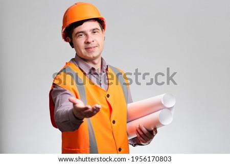 Geslaagd jonge helm werkkleding papier Stockfoto © pressmaster