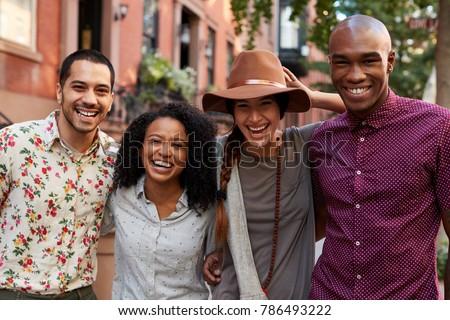 Fronte view felice gruppo amici Foto d'archivio © wavebreak_media