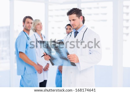 Front view of Caucasian female doctor examining young Caucasian female patient in clinic at hospital Stock photo © wavebreak_media