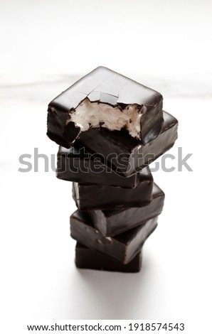 Cake bars filled with cream and cracked chocolate pieces isolate Stock photo © marylooo
