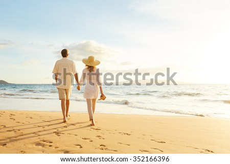 Couple holding hands relaxing on Hawaii beach in sunset. Young people in love in Waikiki travel Hono Stock photo © Maridav