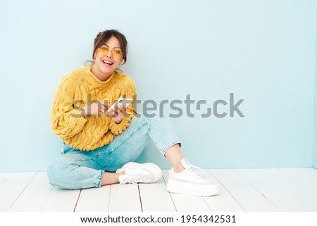 Pretty young woman with hot look and sexy smile sitting near poo Stock photo © HASLOO